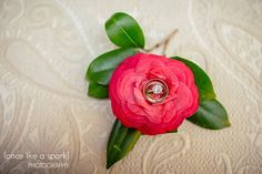 camellia, wedding ideas, ring shot, southern flower, southern wedding, beautiful details, wedding photography :: Dana + Drew's Wedding at The Gardens of Mepkin Abbey and the Rice Hope Plantation in Moncks Corner, SC :: with Krista