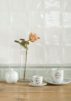 Available from Welby & Wright. Papyrus white field tiles with Mint mouldings and field tiles. From the Cosmopolitan range at The Winchester Tile Company. Handmade ceramic tiles, made in the UK. winchestertiles.com