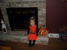 Love this Pumpkin idea - gluing craft balls on pumpkin to spell child's name...the dress is cute too (on etsy)