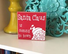 Ho Ho Ho! This HoHoHo Santa Sign makes a fun addition to your Christmas Decor. Add the HoHoHo sign to your mantel, a shelf or use as a centerpiece. The HoHoHo Santa Sign make a fun neighbor gift as well!  The HoHoHo Santa Sign is a hand cut MDF sign painted in a holiday red. The sign says Ho, Ho, Ho with Santas belt in the middle of the sign. Each HoHoHo Santa Sign is sanded to have a finished look. The HoHoHo Santa Sign measures approx. 10in x5in.  **15% COUPON CODE** 1. Pin 3 of our…
