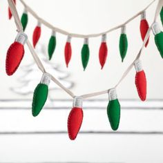 Holiday Lights Garland - Land of Nod (Could totally recreate this for the boy's rooms with felt and bias tape)