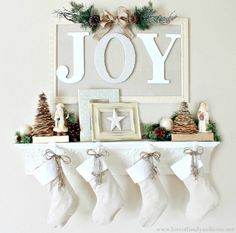 Christmas mantels - white stockings, pine cone trees, white and gold accents - Christmas Mantel Love of Family and Home