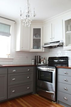 Two toned cabinets.  Slate on the bottom, bright white on the top.  The wooden countertops look great with the slate.  You can buy really cheep butcher block counter tops at Ikea and have them cut to size.