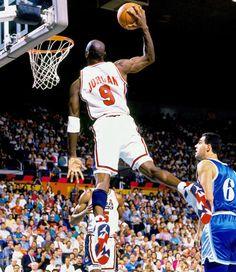 Jordan going up for a dunk rocking the Olympic Jordan VII