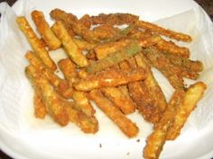 Zucchini Fries.  Dip in egg wash (1 egg beaten with a tbs havy cream), then dredge in 3 cheese blend, fried in coconut oil.