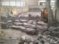 We have split the garden into two distinct levels - Access to the upper garden level is via some natural stone steps, up through a retaining wall, constructed from large granite boulders.