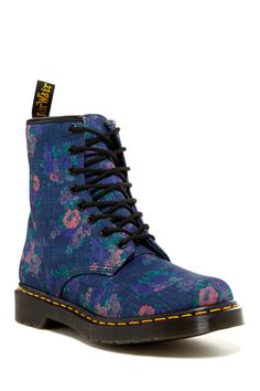 Dr. Martens Lace-Up Floral Boot- I love the contrast of the girly floral and the chunky masculine shape
