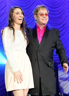 Sara Bareilles and Elton John pose onstage at The Breast Cancer Foundation's 2014 Hot Pink Party at Waldorf Astoria Hotel in New York on April 28, 2014