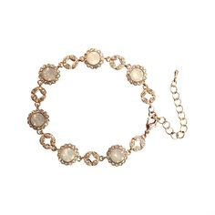 Bracelet with white and clear crystals Miss Beatrice bracelet by Lily and Rose.   Information: Bracelet with white and opal crystals of various sizes.    Length: 16 cm with 4 cm extension   Width: 10 mm    Crystals:   1.4 mm Crystal (Oktant, Austria)   5.3mm White opal (Swarovski, Österrike)