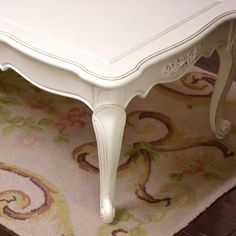 "Accent your sofa with this stunning, long coffee table. It has been painted our popular white and has rose appliques. Accessories shown are not included. 21""d x 52""w x 15.5""t"