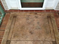 Decorative Concrete - Front door stoop, stamped overlay on top of existing concrete, stained and engraved by Crete Finishings (NC).  www.cretefinishings.com