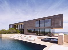 This home in New York is overlooking a pond on one side and the ocean on another