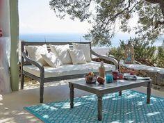 Zona de estar en porche o terraza, de Maisons du Monde