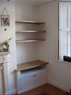 Built in alcove TV unit with scaffold board floating shelves above #diykitchenshelves