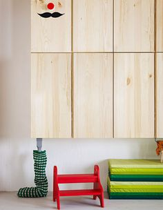An IVAR cabinet placed low on a wall so a child can use it as a doll's house