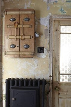 Credit: Holly Jolliffe This cupboard featuring vintage kitchenalia is by Steve Handley and is mounted above an old radiator with built-in plate warmer. Try The Old Radiator Company for vintage designs, and Art Radia for reproductions. Or try Salvo for local reclamation companies.