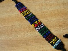This is super awesome!  Green, Yellow, Red, Blue, White and Black Tribal Patterned Friendship Bracelet-- with optional adjustable clasp on Etsy, $13.00