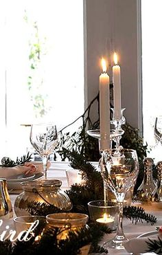 A Christmas table setting with lots of sparkly silver details. See more details at http:// www.songbirdblog.com