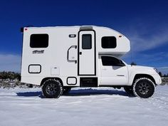 Custom-built RVs are popular, but this Toyota project takes the once-popular pickup-truck camper to the extreme by adding a fully integrated shell. Tiny Camper Trailer, Pickup Camper, Camper Van, Diy Camper, Rv Travel Trailers, Vintage Campers Trailers, Toyota Motorhome, Toyota Tacoma 4x4, Tacoma Truck