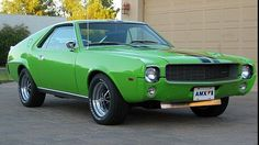 1969 Big Bad Green AMC AMX sports car - Rare original Big Bad Green mono-chrome paint - 390 CI 4-barrel - Largest engine offered for AMX in 1969 - Factory Go-Pack performance option - Factory Black racing stripes - HD automatic transmission - 3.54 twin grip rear axle