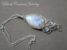 https://www.etsy.com/listing/487901749/rainbow-moonstone-teardrop-and-sterling?ref=shop_home_active_48
