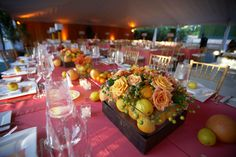 If you love #citrus colors, why not incorporate actual #fruit into your centerpieces? Photograph by: Paul Barnett Photographer