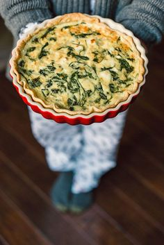 Serving a spinach goat cheese quiche at Christmas morning brunch