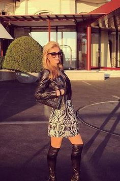 Paris Hilton wearing Dita Paradis Sunglasses in Black, Alice + Olivia Loran Printed Skirt in Black, Cesare Paciotti Thigh High Botts, Stella McCartney Falabella Tiny Quilted Crossbody Chain Bag and Alice + Olivia. Black Long Skinny Tank Top