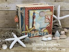 [Video Tutorial] By the Sea Mini Album - Donna Kauffman Introduction File Folder Mini Book step by step tutorial for Graphic 45 Products: By the Sea - Deluxe Collector's Edition, Tag Staples, Matte Pearl Gems, Metal Dies Graphic 45, Mini Albums, Happy Crafters, Handmade Scrapbook, Memory Album, Memory Books, Mini Album Tutorial, Mini Books, Pattern Paper