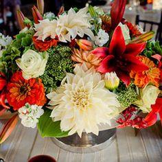 Centerpiece designed with dahlias, lilies, sedum, orchids, stock, hydrangea and zinnias