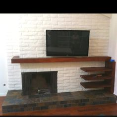 Schulbach builders, Ventura CA designed and built this floating shelf/mantel to house the components and hide the cables to the flat panel tv that was hung on a solid masonry wall. The shelves and mantel are hollow with hidden access panels to fish the cables through.