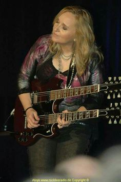 LOVE WHEN SHE WHIPS OUT HER DOUBLE BARRELED GUITARS! (which she bought in Sioux city... just sayin' ;)
