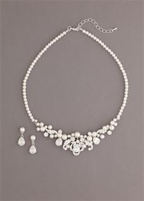 """This gorgeous necklace set will make you look absolutely stunning on your special day!  Pearl set is accented with mix of oval shaped crystals.��  Perfect for any bride on her special day - a great update to a traditional look.  Necklace measures approx. 15""""L   2-1/2"""" extender.  Earrings measure 3/4"""" and secure to ear with a post and clutch closure.�  Imported.  Available in Silver."""