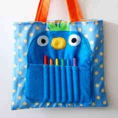 "The monster is made with polar fleece and eco felt. I stuffed each tote with a sketchbook and crayon ""teeth."""