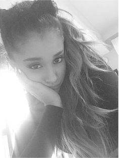 After letting her hair down at the MTV EMA, Ariana Grande just had to bring back her cat ears! The singer posted this super serious black and white selfie, showing off her bright white manicure and pretty eye makeup.