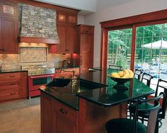 Love the cherry wood cabinets and darker counter tops with lighter floors.