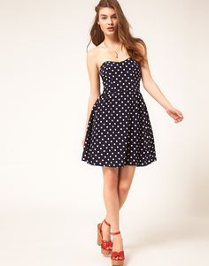 i've been trying to look for this dress for a few years now . it's so simple and beautiful . i love dots :D