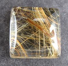 rutilated quartz...those are gold strands running through the quartz...beautiful what nature gives us.
