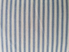 One Yard Denim Blue Ticking Stripe Fabric  Its a 100% cotton woven stripe fabric. Fabric is 44 wide. If ordering more than one yard it will be one continuous piece. Uses include womens and childrens apparel, home decor projects, kitchen and dining room textile projects, lining fabric, quilting, handbags, totes, & craft accent fabric. This is not down or feather-proof. If you want me to custom make pillow covers in this fabric send me a message.