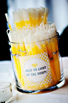 """For a bright exit at the end of your wedding reception, offer glow sticks as favors to """"light up the night!"""" {@durginphoto}"""