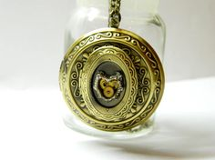 Four photo locket Steampunk jewelry Mechanical heart 4