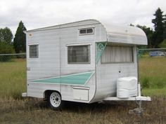 1965 Safari vintage trailer. So very sweet! Do you think you could turn around in it?