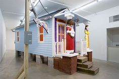 """Shotgun style houses were the """"most popular style of house in the Southern United States from the end of the Civil War (1861–65), through to the 1920s."""" They're simple and small and artist Marjetica Potrč, along with sustainable design firm Futureproof, wants to bring them back to New Orleans. Marjetica Potrč's prototype includes opportunities for solar power and rainwater catchment. The sculptural pillars symbolize the people of New Orleans as the strength that will rebuild the city."""
