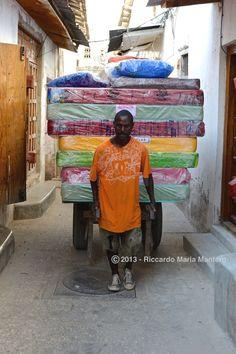 Mattress trasnporter  In Zanzibar mattresses are colored too.   Follow my Boards and my IG @riccardo_mantero for more!