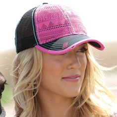 Pink lace covers the front of this black mesh trucker cap. Distressed marks  on the dd7c1f0aa8e