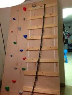 I thought I would add in how we made the climbing wall as a separate post. The climbing wall is a success. The boys love it! Toddler Climbing Wall, Indoor Climbing Wall, Kids Climbing, Rock Climbing, Diy Pared, Sensory Rooms, Sensory Tubs, Sensory Wall, Sensory Activities