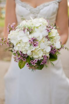 I am absolutely in love with this for my bouquet! I have to have this. Maybe vice versa, purple flowers with white accenting and my maids with this actual bouquet