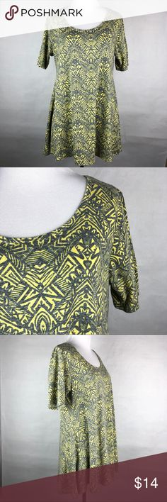 LULAROE Perfect T Top Yellow Gray Geometric Design Lularoe Short sleeve perfect tee is beautiful and flowy.  It has dark gray and yellow geometric/tribal designs and slide slits.  Perfect with a pair of leggings and can be dressed up with a belt! . -✨ GREAT CONDITION ✨ please feel free to ask me any questions before purchasing. . - Size: SMALL . ***Offers are always welcome! LuLaRoe Tops Blouses
