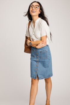 Take your time and enjoy life's little moments in this chic, knee length denim skirt! With a button up front and pockets, this skirt is the perfect addition to any gal's wardrobe.