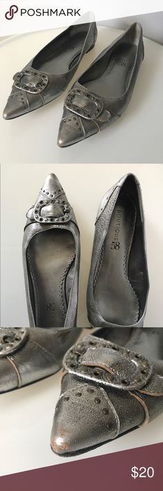 Boutique 58 Silver Metallic Pointed Toe Flats Quality construction and amazing design for someone with style. These metallic flats make wearing flats fun. You won't miss your heels with these beautiful shoes and they will go with everything in your fall wardrobe. Amazing shoe! Some wear pictured on tips of the toe and in we area.  Item: F-2-442 Boutique 58 Shoes Flats & Loafers